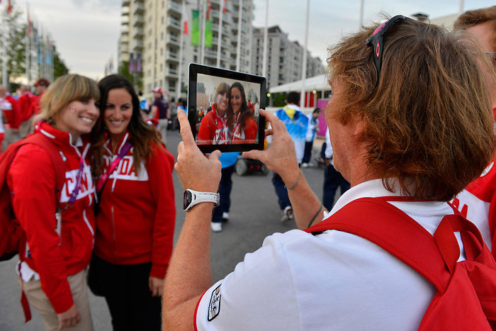 LONDON, ENGLAND 26/08/2012 - Members of Team Canada take photos after the Olympic Welcoming Ceremony at the London 2012 Paralympic Games the Paralympic Village Plaza. (Photo: Phillip MacCallum/Canadian Paralympic Committee)
