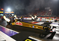 Apr 21, 2017; Baytown, TX, USA; NHRA top fuel driver Leah Pritchett (near) races alongside teammate Antron Brown during qualifying for the Springnationals at Royal Purple Raceway. Mandatory Credit: Mark J. Rebilas-USA TODAY Sports