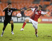 Eric Brunner (5) of the Portland Timbers fights for the ball with Dwayne De Rosario (7) of D.C. United during the game at RFK Stadium in Washington, D.C. D.C. United tied the Portland Timbers, 1-1.