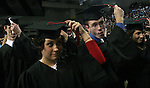 Drake University graduates move their tassles from right to left during commencement exercises in 2005...The private University in Des Moines, Ia., has been lauded for it's outstanding programs in the arts in addition to having one of the best law schools and pharmacy departments in the country.