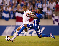 Brayan Beckeles (3) of Honduras blocks the shot of Alvaro Saborio (9) of Costa Rica during the quarterfinals of the CONCACAF Gold Cup at M&T Bank Stadium in Baltimore, MD.  Honduras defeated Costa Rica, 1-0.