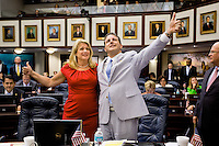 TALLAHASSEE, FLA. 5/3/13-SESSIONEND050313CH-Rep. Jimmy Patronis, R-Panama City, right, and Rep. Kathleen Peters, R-South Pasadena, celebrate the passage of the environmental regulation bill during the final day of the legislative session May 3, 2013 at the Capitol in Tallahassee...COLIN HACKLEY PHOTO