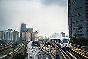 A RapidKL train (local tube) approaches a train station in Kuala Lumpur, Malaysia.