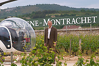 Michel Picard owner with his helicopter dom m picard chateau de ch-m chassagne-montrachet cote de beaune burgundy france