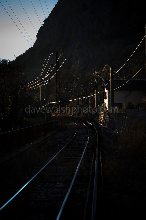 Ligne de Cerdagne , the line for the Train Jaune or Yellow Train illuminated at sunset in Villefranche de Conflent, in the Pyrenees Orientales.