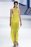 Cristina Herrmann walks runway in a Yellow silk chiffon eyelet tiered dress with yellow mackintosh cotton drawstring peplum belt, and Yellow silk chiffon drawstring maxi skirt by Vera Wang, for the Vera Wang Spring 2012 collection, during Mercedes-Benz Fashion Week Spring 2012.