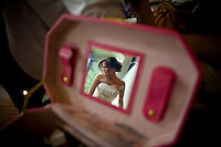 Silvia is reflected in the mirror of a makeup case as she gets ready for her wedding at her home in Bothell, WA. (Photo by Andy Rogers/Red Box Pictures)(Photo by Scott Eklund/Red Box Pictures)