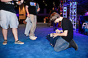 "August 29, 2010. Raleigh, North Carolina.. Justin Deese, ie  ""iGotUrPistola"", of team Final Boss, signs autographs after his team won the $20,000 Halo 3 purse.. Major League Gaming (MLG), the league for professional videogame players, held their 50th Pro Circuit competition at the Raleigh Convention Center, with gamers from all over the country coming to for 3 days of competition in Halo 3, Tekken 6, Super Smash Bros. Brawl, Starcraft 2 and World of Warcraft."
