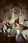 Photo of old men playing cards at The Men's Club in Sorrento, Italy.