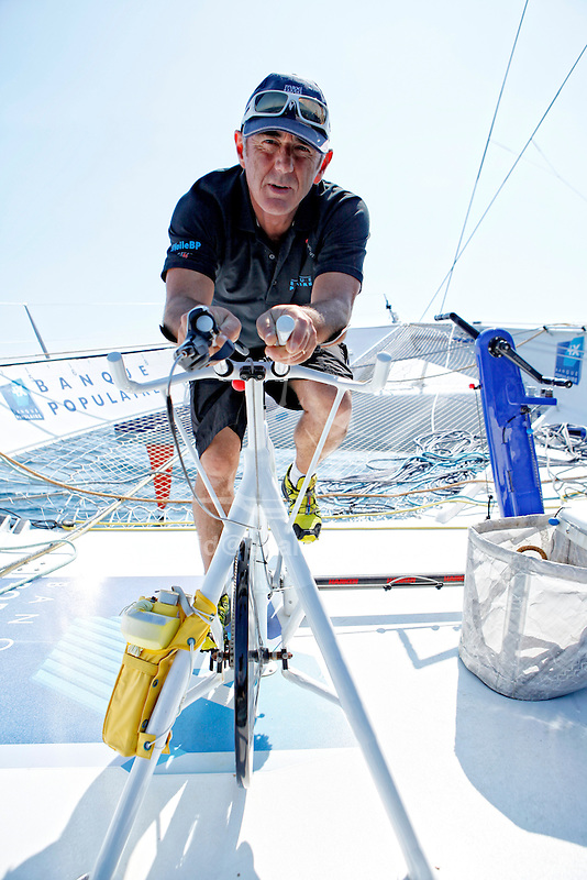 "Loick Peyron onboard the Maxi Trimaran Solo Banque Populaire VII in preparation for ""La Route du Rhum""."