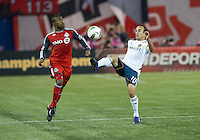 07 March 2012: LA Galaxy forward Landon Donovan #10 and Toronto FC defender Ashtone Morgan #5 in action during a CONCACAF Champions League game between the LA Galaxy and Toronto FC at the Rogers Centre in Toronto..The game ended in a 2-2 draw.