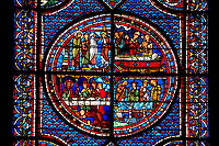 Medieval stained glass Window of the Gothic Cathedral of Chartres, France - dedicated to the Life of St Mary Magdalen. Central panel - bottom left - Mary washing Christ's feet in the house of Simon the Pharisee, bottom right - Death of Lazarus, top left - Their neighbours try to console Mary and Martha, top right - Funeral of Lazarus.  A UNESCO World Heritage Site..