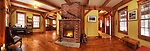 Timber frame Canadian country house interior living room with fireplace, Muskoka, Ontario, Canada