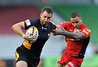 Chris Mayor in possession. J.P. Morgan Premiership Rugby 7s match, between London Wasps and Saracens on July 13, 2012 at the Twickenham Stoop in London, England. Photo by: Patrick Khachfe / Onside Images
