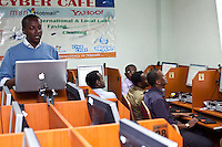 Denis Gikunda, localization manager for Google Africa leading a group of Somalis in an Eastleigh cyber cafe in a translation exercise prior to the launch of Google's Somali language interface. The project is part of Google's ongoing efforts to translate it's interface into  the most used African languages.