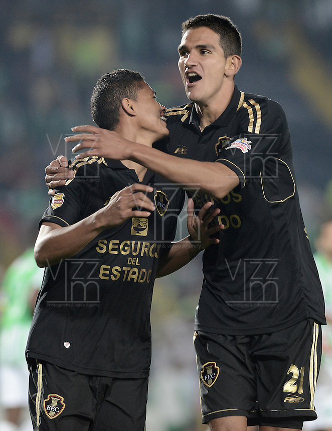 BOGOTÁ -COLOMBIA-01-11-2014. Jorge Ramos (Izq) jugador de Fortaleza FC celebra un gol anotado a Atlético Nacional durante partido por la fecha 17 de la Liga Postobón II 2014 jugado en el estadio Nemesio Camacho El Campín en Bogotá./ Jorge Ramos (L) player of Fortaleza FC celebrates a goal scored to Atletico Nacional during the match for the 17th date of Postobon League II 2014 played at Nemesio Camacho El Campin stadium in Bogota. Photo: VizzorImage / Gabriel Aponte / Staff