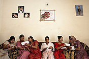 A group of surrogate mothers share a lighter moment in Rabina's house in Anand, Gujarat, India. Rabina now mentors surrogate mothers and houses women throughout their pregnancy.