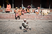 Sadhus are seen begging outside the Pashupathi Nath Temple in capital Kathmandu, Nepal