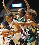 Mississippi's Kenyotta Jenkins dribbles against Southeastern Louisiana's Nanna Pool, back, and Aja Gibson (2) in Oxford, Miss. on Friday, November 9, 2012. (AP Photo/Oxford Eagle, Bruce Newman)