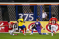 Narciso Mina (8) of Ecuador beats Chile goalkeeper Miguel Pinto (1) to score the first goal of the match. Ecuador defeated Chile 3-0 during an international friendly at Citi Field in Flushing, NY, on August 15, 2012.