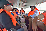 John Nduna (right), the general secretary of the ACT Alliance, rides a boat to Jinamoc Island, part of the municipality of Basey in the Philippines province of Samar that was hit hard by Typhoon Haiyan in November 2013. The storm was known locally as Yolanda. Accompanying him are Minnie Anne Calub (left), the emergency coordinator for the National Council of Churches in the Philippines, and Femia Baldeo, country director in the Philippines for Lutheran World Relief. Both agencies are members of the ACT Alliance, which has been providing a variety of forms of assistance to survivors here, and Nduna and other ACT Alliance leaders spent several days in this and other affected communities learning first hand about the network's emergency response and long-term plans for recovery and rehabilitation.