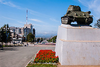 Russia, Sakhalin, Yuzhno-Sakhalinsk. An old Soviet era tank serves as a monument.