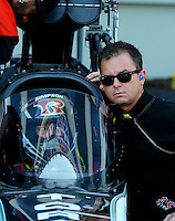 Sep 13, 2013; Charlotte, NC, USA; Billy Torrence (in the cockpit) gets some instruction from his son NHRA top fuel dragster driver Steve Torrence during qualifying for the Carolina Nationals at zMax Dragway. Mandatory Credit: Mark J. Rebilas-