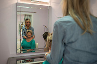 NWA Democrat-Gazette/ANTHONY REYES &bull; @NWATONYR<br /> Rhonda Ceola, owner of With Grace Salon, takes a look at client Kathy Rinks hair Tuesday, Aug. 18, 2015 at With Grace Salon in Springdale. Ceola provides custom-made wigs, hair pieces and other services for women who struggle with hair loss.