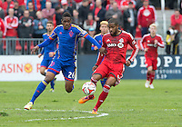 Toronto, Ontario - April 12, 2014: Colorado Rapids forward Deshorn Brown #26 and Toronto FC defender Jeremy Hall #25 in action during the 2nd half in a game between the Colorado Rapids and Toronto FC at BMO Field in Toronto.<br />