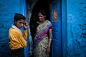 A woman from the Devanga caste speaks to her son outside their house in Mahesh, Hooghly in West Bengal, India.  Photo: Sanjit Das/Panos for The Wall Street Journal. Slug: ICASTE