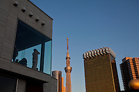 Tourists look at Tokyo Skytree from the windows of a building in Asakusa, Tokyo, Japan Sunday February 10th 2013