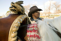 2 December 2006 - New York City, NY - R. W. Hall (C), aka Curly, a member of the Federation of Black Cowboys, prepares to ride at the Cedar Lanes stables in the borough of Queens in New York City, USA, 2 December 2006. The Federation gathers black men and women who recreate the heritage of black cowboys, teach kids to ride and put on 'rodeo showdeos'.