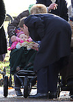 ©Albanpix.com Pictures by Alban Donohoe.Prince William plays with a child in a pushchair  at the end of  the  Sandringham  Sunday Church service 27 December 09