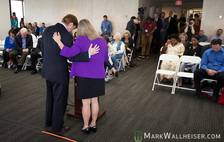 Mrs. Pam Olsen, right, pays for and with Adam Putnam, Florida Commissioner of Agriculture, during a prayer rally on the National Day of Prayer on the 22nd floor of the Florida Capitol in Tallahassee, Florida.