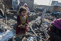 Aftermath of fire at Chamne Babrak refugee camp. 31-12-13