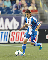 Philadelphia Union midfielder Michael Farfan (21) brings the ball forward.  In a Major League Soccer (MLS) match, the New England Revolution (dark blue) defeated Philadelphia Union (light blue), 5-1, at Gillette Stadium on August 25, 2013.