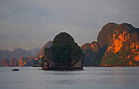 Hạ Long Bay, in northeast Vietnam, is known for its emerald waters and thousands of towering limestone islands topped by rainforests. Junk boat tours and sea kayak expeditions take visitors past islands named for their shapes.