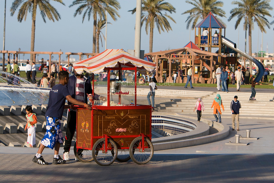 Tripoli, Libya, North Africa - Friday Afternoon in the Public Park, Playground, near the Green Square.  Popcorn Vendor, Children's Slide in Background.