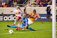 Macoumba Kandji (9) of the Houston Dynamo watches his shot slide wide of the post. The New York Red Bulls defeated the Houston Dynamo 2-0 during a Major League Soccer (MLS) match at Red Bull Arena in Harrison, NJ, on August 10, 2012.