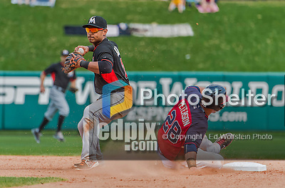 19 March 2015: Miami Marlins infielder Donovan Solano attempts to turn a double-play during Spring Training action against the Atlanta Braves at Champion Stadium in the ESPN Wide World of Sports Complex in Kissimmee, Florida. The Braves defeated the Marlins 6-3 in Grapefruit League play. Mandatory Credit: Ed Wolfstein Photo *** RAW (NEF) Image File Available ***