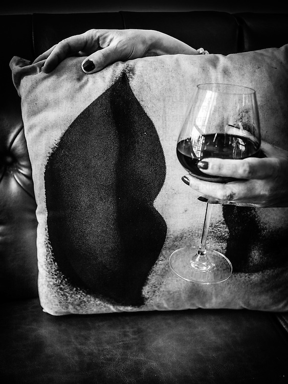 Glass of wine held by female hand