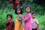 Asia, Nepal, Kathmandu, Kirtipur. Children of Kirtipur wait for turn on swing.
