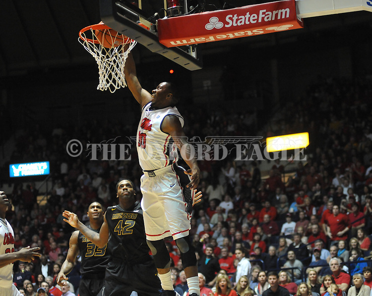 "Ole Miss' LaDarius White (10) dunks vs. Missouri's Alex Oriakhi (42) at the C.M. ""Tad"" Smith Coliseum on Saturday, January 12, 2013. Ole Miss defeated #10 ranked Missouri 64-49."