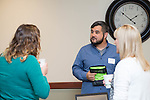 Mark Riley, a Technical Support Analyst in the College of Health Sciences and Professions, speaks to people at his booth at the Campus Communicator Network Expo in Nelson Commons on Wednesday, May 11, 2016. © Ohio University / Photo by Kaitlin Owens