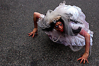 A reveller takes part in the annual Zombie Walk in Buenos Aires October, 2013. Photo by Juan Gabriel Lopera / VIEWpress.