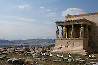 ATHENS, GREECE - APRIL 17 : A general view of the Porch of the Caryatids of the Erechtheum with the city in the distance, on April 17, 2007, in Athens, Greece. The Erechtheum was built on the Acropolis, between 421 and 405 BC, in the Ionic Order. The Porch of the Caryatids is on the South side of the Temple and comprises 6 sculptures of maidens bearing libations, in place of columns, standing on a high base and supporting a decorated flat roof. The Caryatids wear a Peplos with a short cloak hanging from their shoulders. (Photo by Manuel Cohen)