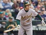 Oakland Athletics Gabe Gross watches his infield hit to first base in the first inning against the Seattle Mariners opening home game of the season at SAFECO Field in Seattle April 12, 2010. Gross grounded out to Mariners first baseman Casey Kotchman. The Athletics beat the Mariners 4-0.