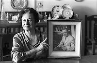 Deloraine Brohier at her home in Colombo. holding a portrait of her father, R.L. Brohier.