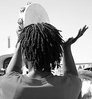 playing the tambourine in mardi gras parade