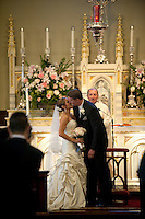 A bride and groom kiss at the during their wedding at the Church of the Nativity, Menlo Park, CA.